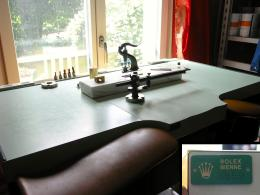 An authentic Rolex watchmaker bench for assembly and tonearm assistance.
